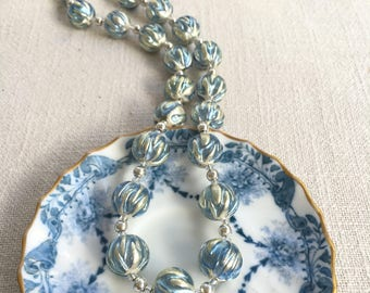 Diana Ingram 20 inch (51cm) Murano glass necklace with cornflower blue appliqué over white gold leaf sphere beads on 925 Sterling Silver.