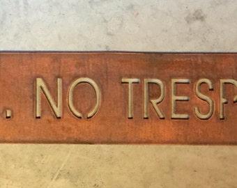 Metal PRIVATE NO TRESPASSING sign in copper finish