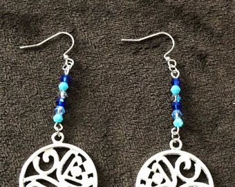 Silver earrings with blue crystal accent beads.