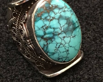 Ring ~ Turquoise Saddle Ring  Turquoise Stone of Joy Tears and Sky Hidden in Mother Earth. Sterling Silver