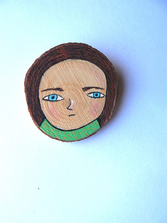 Brooch made in wood. Hand painted portrait of woman. 5 x 4 cm.