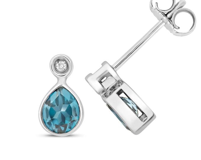 9ct Gold Diamond & Pear Cut 5x4mm London Blue Topaz Stud Earrings