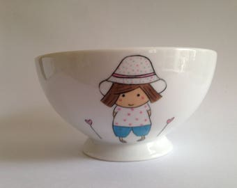 Bowl with a little girl with hat with polka dots, flower heart illustration Amélie Biggs