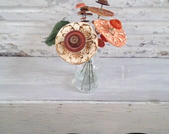 burnt orange, brown, and orange button flower bottle bouquet