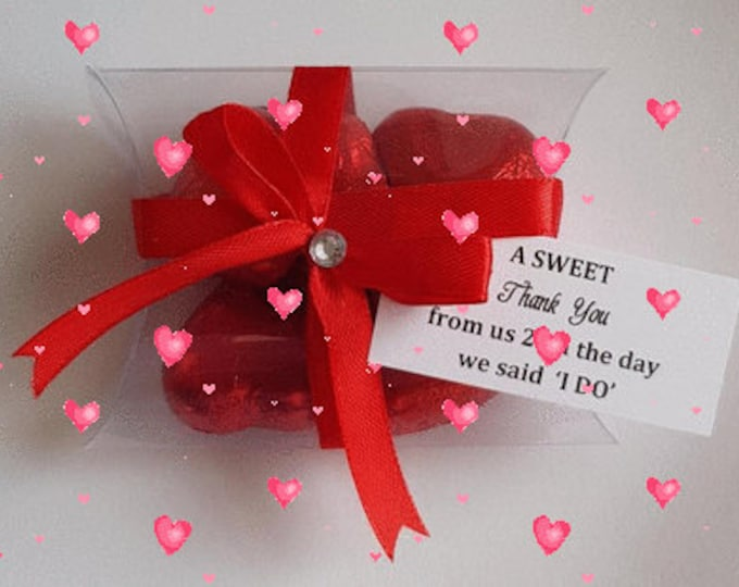 Red chocolate hearts in pillow box wedding valentine favours