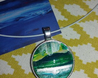 Cable necklace and its unique green pendant