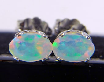 6x4mm Ethiopian Welo Opals, AAA+ grade Fiery Opals,  Oval Natural Ethiopian Opals, Sterling Silver Ear studs with excellent play of color.