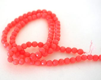 10 coral 4mm faceted round beads