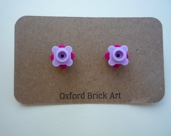 Double flower earrings in a choice of pink, magenta, green, red and yellow Lego® pieces with hypoallergenic surgical steel posts and backs.