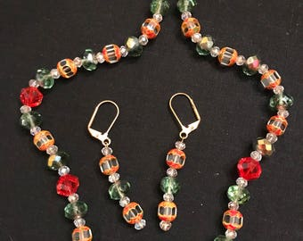 """Orange and Clear Glass Druk 21"""" Necklace and Earring Set with Green and Gold Crystals"""