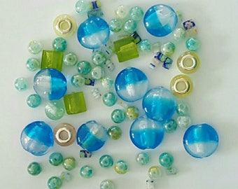 Set of 81 assorted beads - blue green yellow