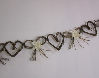 Grapevine Twig garland with sola flowers  - hearts and bows