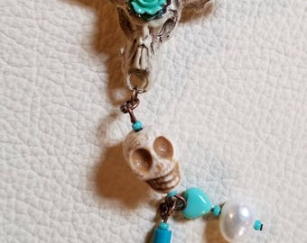 Hand painted cow skull charm with skull and charms
