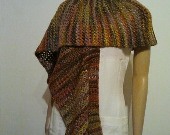 Long knitted scarf in autumn colors