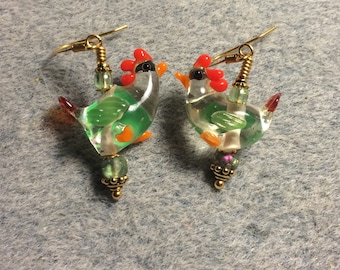 Clear and light green lampwork chicken bead earrings adorned with light green Czech glass beads.