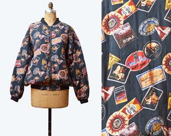 Vintage 80s Quilted Jacket Hotel Travel Sticker Print Silk Jacket / 1980s Zip Up 90s Vintage Retro Black Red Blue Medium