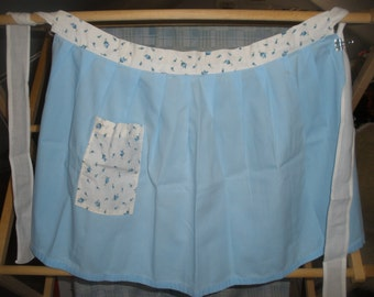 Vintage handmade blue and contrasting floral cotton apron, reminiscent of the days of the 1950's. Sweet fresh looking apron.