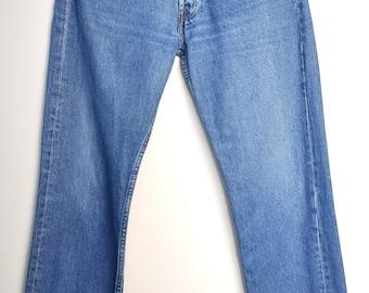 Vintage 90s Levi's 501 blue denim jeans, Made in Spain, Medium wash, Medium to High waist, Button fly, 90s hipster blue jeans, 29 inch waist