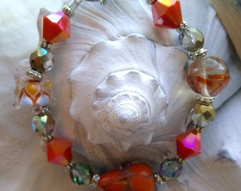 Orange Lampwork and Italian glass with Faceted Crystal Beaded Bracelet with Bali Silver Accents