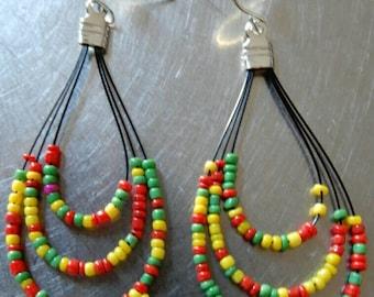 Multicolored seed bead tear drop shape earrings/ rastafarian earrings