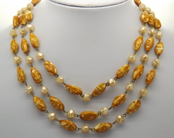 A gorgeous retro 1950's  60's period triple row vintage jewelry necklace made of mixed finished knobbly graduated beads with push in clasp