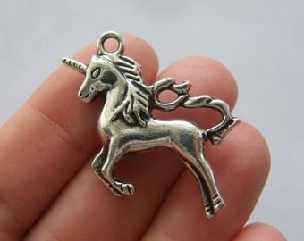 2 Unicorn charms antique silver tone A693