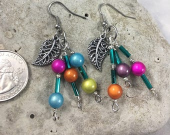 Earrings. Colorful green, pink, orange, blue dangle earrings with silver feather adornment. (A52)