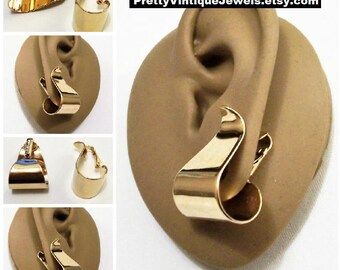 Avon Curved Hoops Clip On Earrings  Gold Tone Vintage 1977 Polished Ribbons Wide Graduated Curl Under Bottom