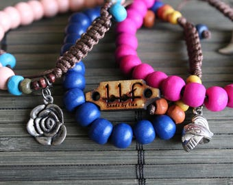 Beaded bracelets with assorted charms