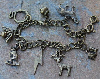 Antique Brass Wizards and Witches Charm Bracelet-  lightning bolt, stag patronus, owl, glasses, Sirius dog, cauldron, snake -Free Ship USA