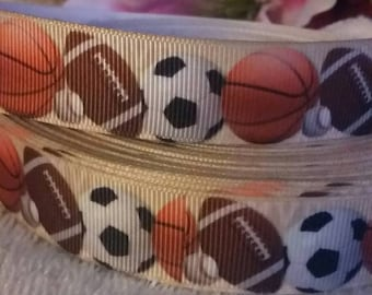 3 yards, 7/8' grosgrain ribbon with sports design