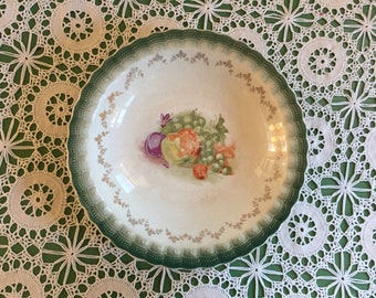 Green Rimmed Vintage Bowl with Fruit Design and Gold Accents