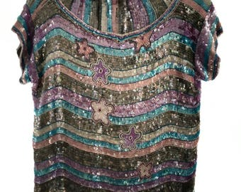 Vintage sequin disco outfit with skirt and shirt.