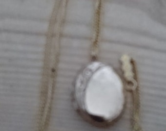 Vintage oval shaped rolled gold locket and chain