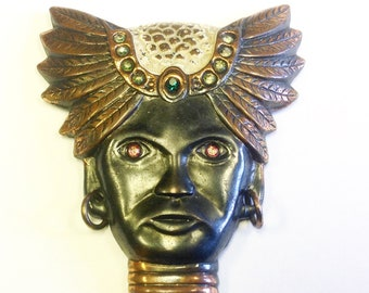 Art Deco, figural brooch with turbaned and bejewelled head.