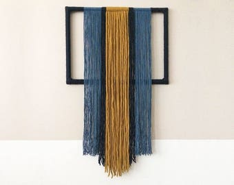 textile wall hanging with yarn wrapped frame | contemporary fiber art | colorful interior decoration |  blue and ochre geometric tapestry