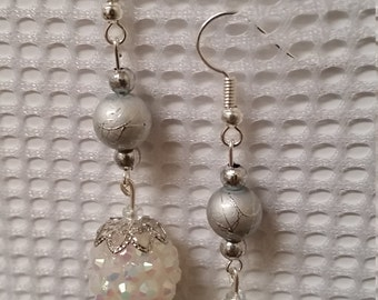 Silver earrings with iridescent snowball charm