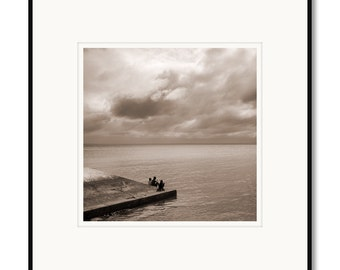 Black and white photography, sepia prints, Philippines, Bantayan Island ferry, boys fishing, tropical island, tropical lifestyle village