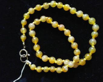 Sunflower Yellow colored clear beads