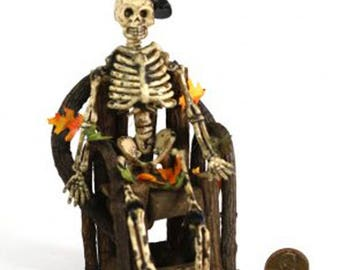 Seated Halloween Skeleton with a Top Hat