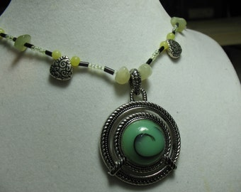 Spiral of life. Peridot, Korean jade, metal and glass beads necklace.