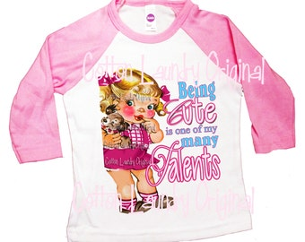 Childrens Raglan tee shirt  Being Cute is one of my many Talents ...Ooak  by Cotton Laundry