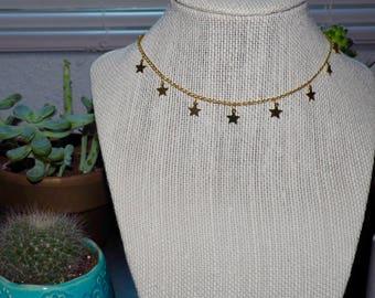 Comet choker, gold star dangle