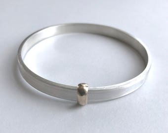 Handmade sterling silver and gold bangle