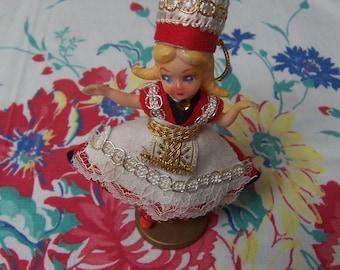 vintage plastic folk art doll ornament