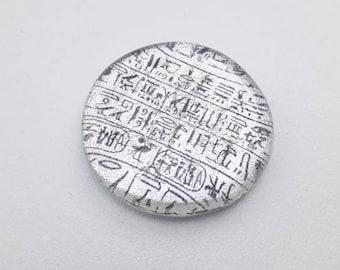 Hieroglyphs cabochon, fused dichroic glass with hieroglyph decoration.
