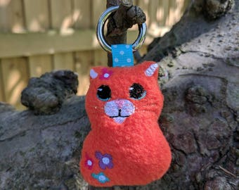 Handmade Ginger Cat Key Ring / Bag Charm / Book Bag Tag, Ginger fleece with embroidered face / flowers, with stainless carabiner key ring