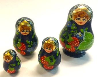 Vintage Russian Matryoshka Nesting Dolls Red Strawberries on Blue Background Gold Accent