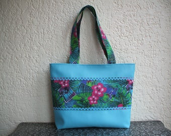 Turquoise leatherette  bag with tahitian fabic, leaves and flowers patterns