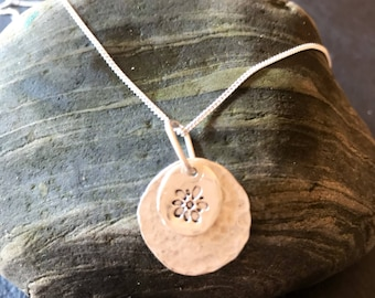 Sterling silver pendant with flower stamp